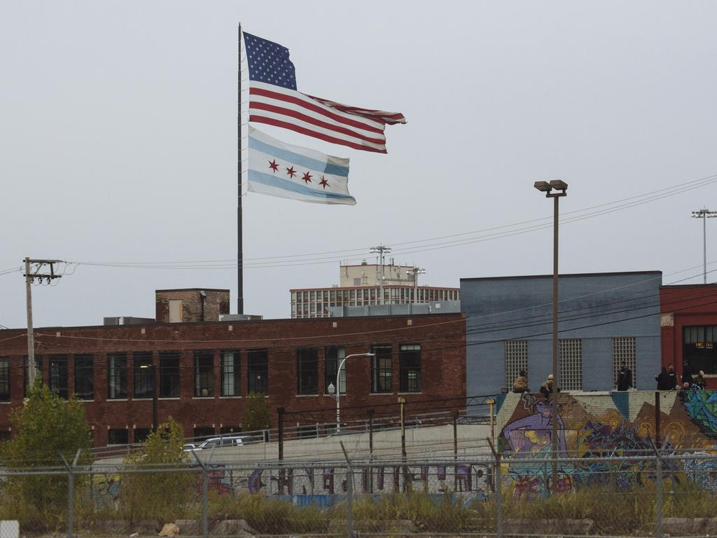 A ripped American flag flies above a Chicago Flag in the River West neighbourhood of Chicago, Illinois, USA. Picture: Angus Mordant for News Corp Australia