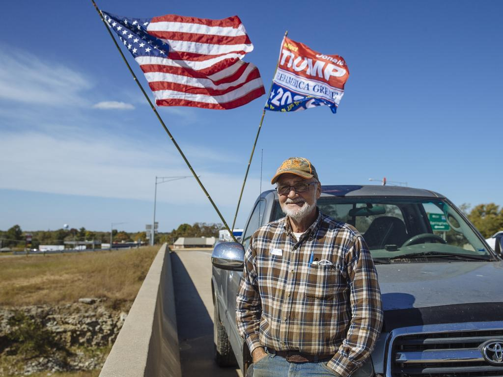 Howard Fuller, 70, spends two hours a day on a highway overpass in Lebanon, Missouri, encouraging people to vote for Trump. Picture: Angus Mordant for News Corp Australia