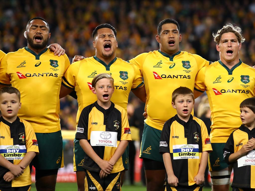 The Wallabies will stand during the anthem. (Photo by Cameron Spencer/Getty Images)