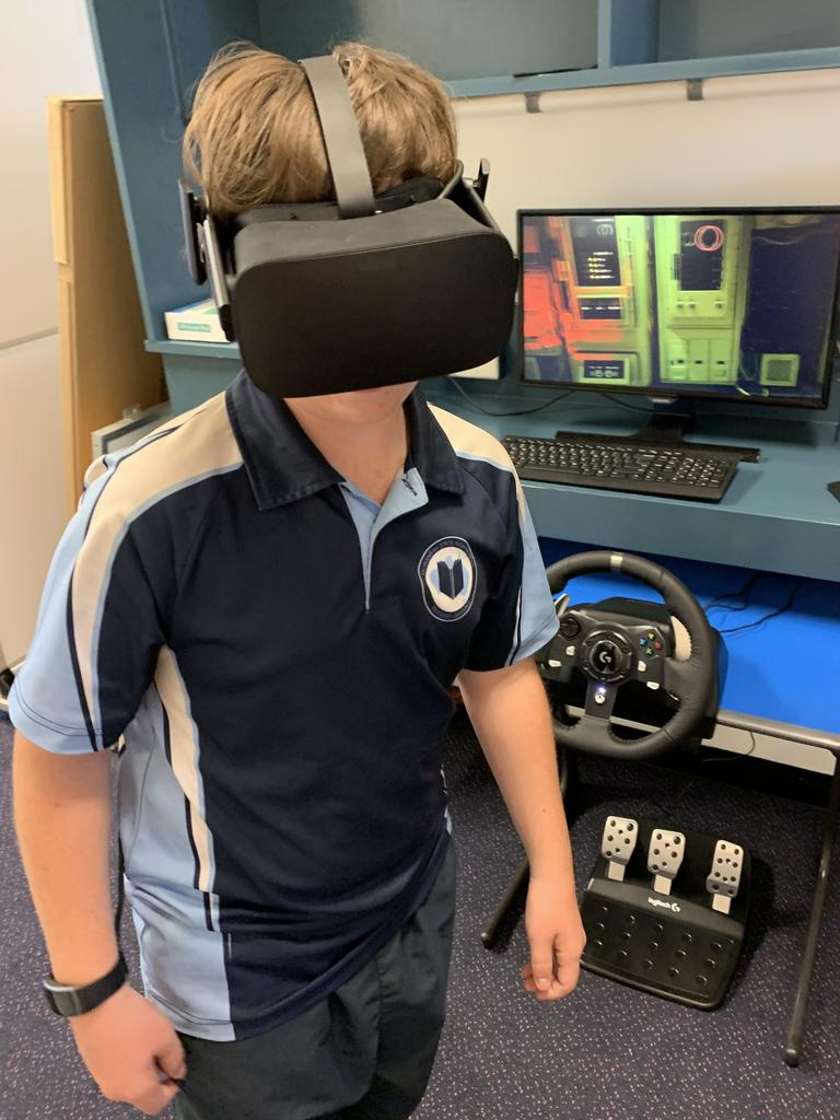 Moranbah State School student Connor, 13, testing out the new virtual reality hub developed by the Endeavour Foundation. Picture: Contributed