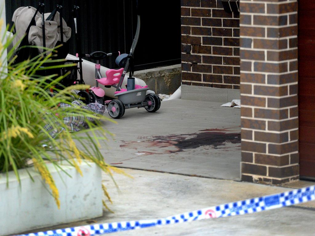 The bloodied crime scene of a neighbouring property where Mejid Hamzy stumbled after being shot. Picture: Jeremy Piper