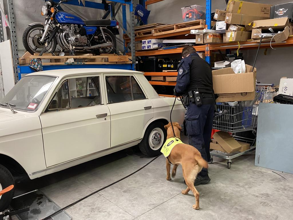 Police searching the warehouse which was full of vintage cars.