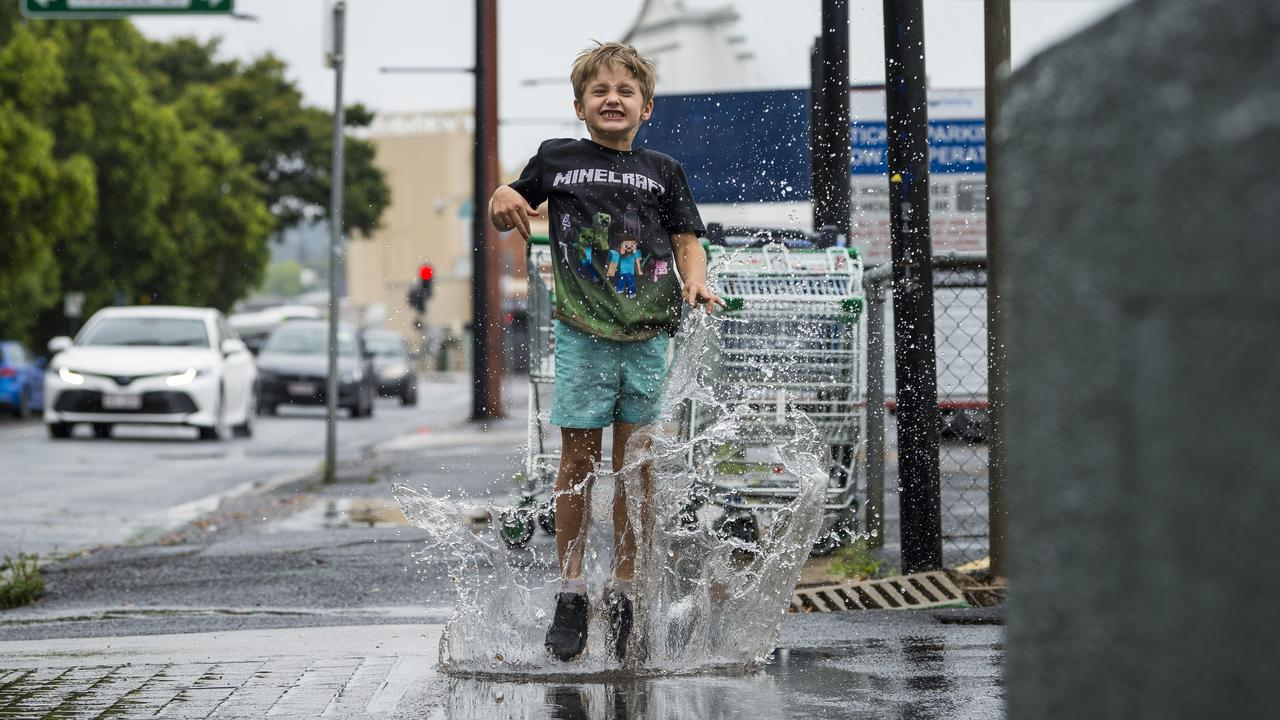 Chael French jumps in a puddle near Victoria St as steady rain falls across Toowoomba, Saturday, October 24, 2020. Picture: Kevin Farmer