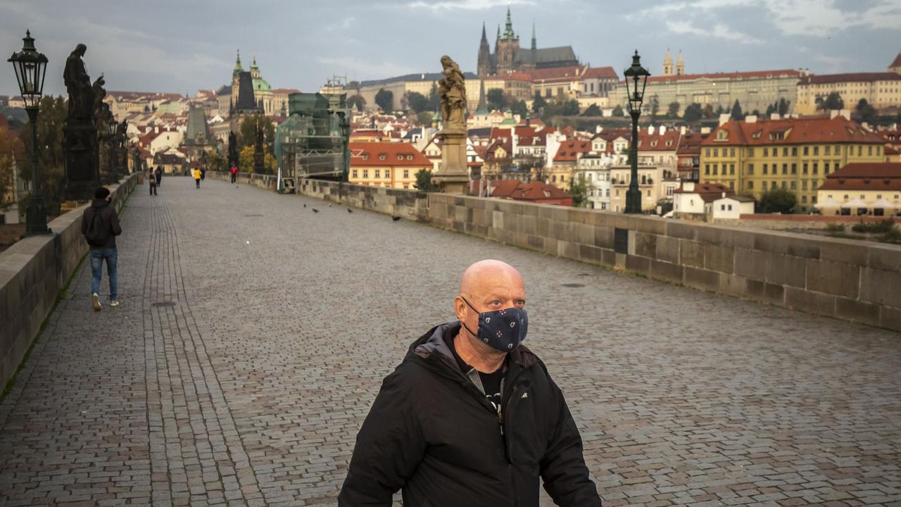 A man walks on the medieval Charles Bridge, Prague, in the Czech Republic. The Czech Republic is under partial lockdown until November 3. Photo: Gabriel Kuchta Getty Images.