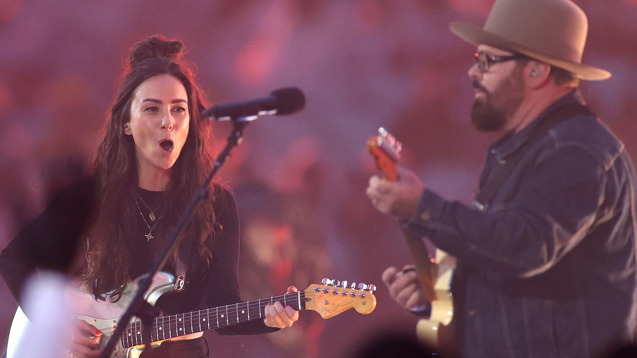 Andrew Farriss performs with Amy Shark. Picture: Getty