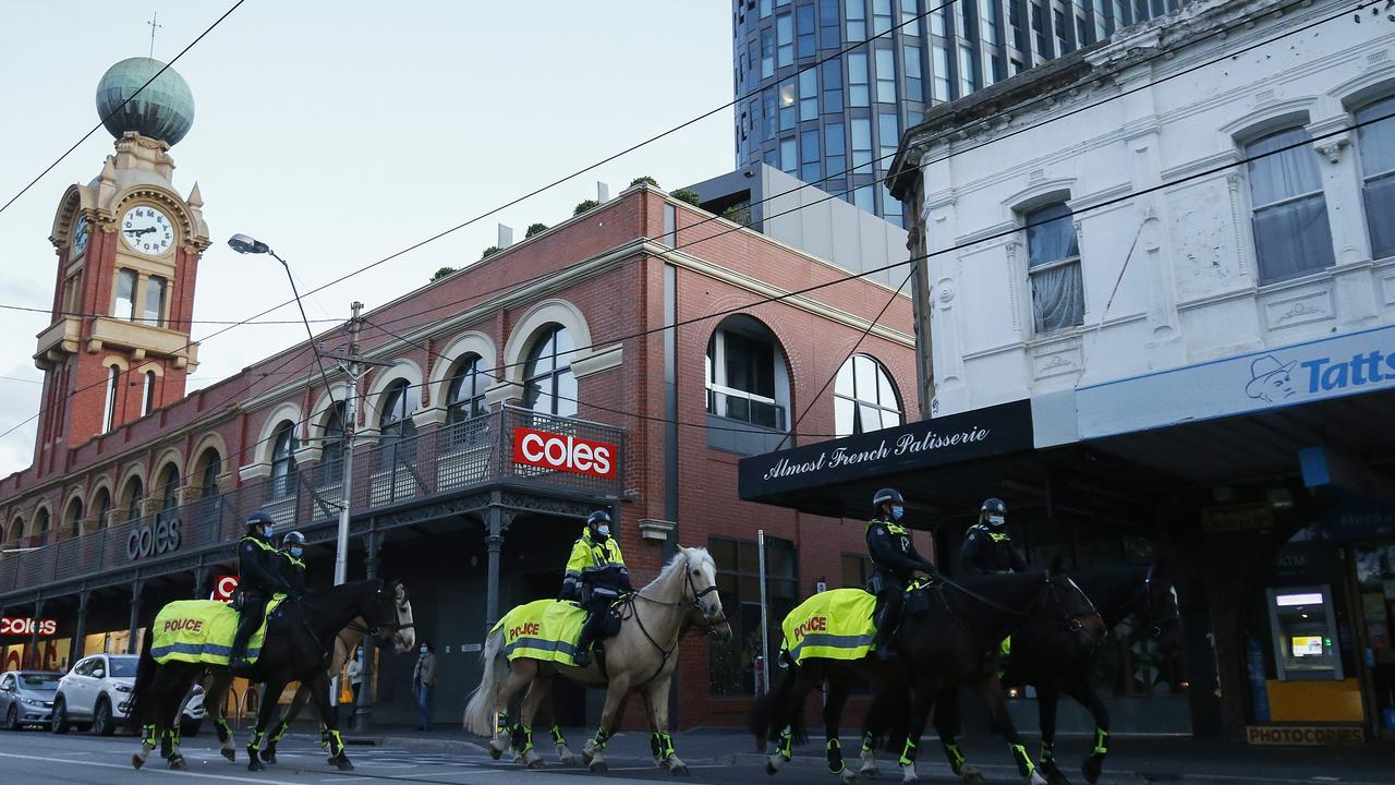 Police patron a deserted Swan St in Richmond on Grand Final day. Picture: Daniel Pockett/Getty Images