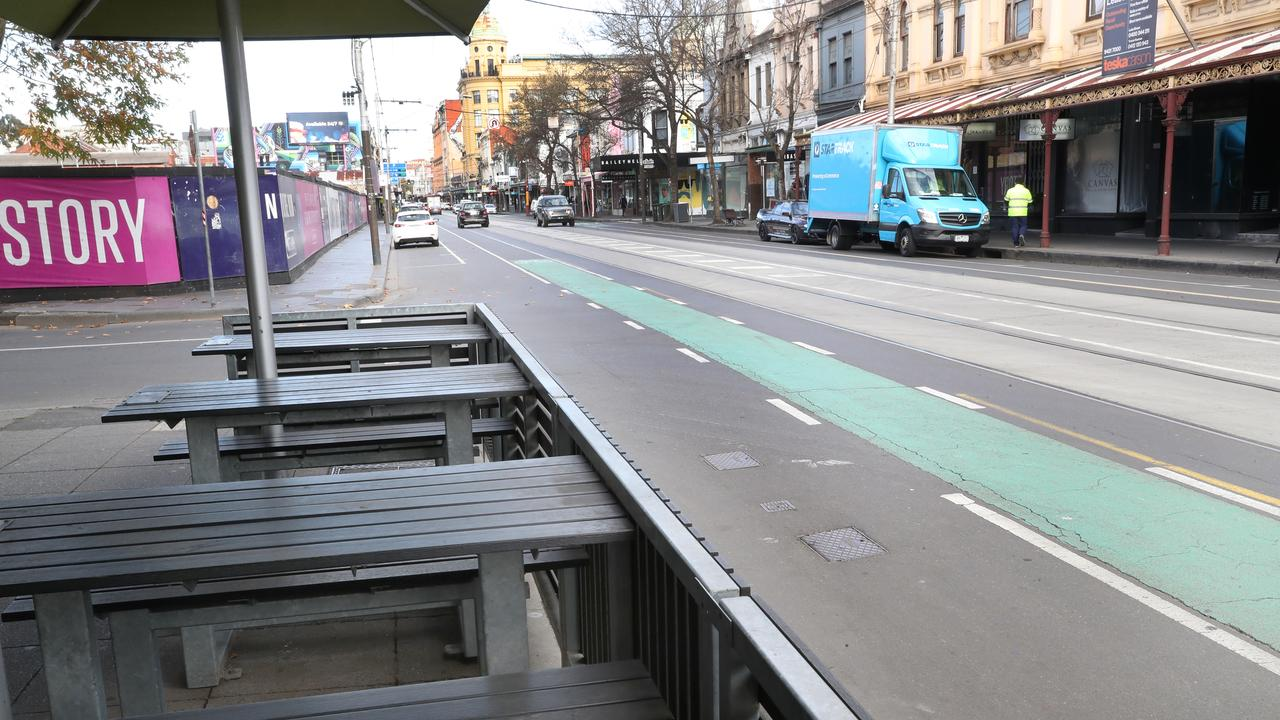 Chapel Street has remained deserted since this photo taken on the first day of Melbourne's second lockdown, then announced as six weeks, on July 3. Picture: David Crosling
