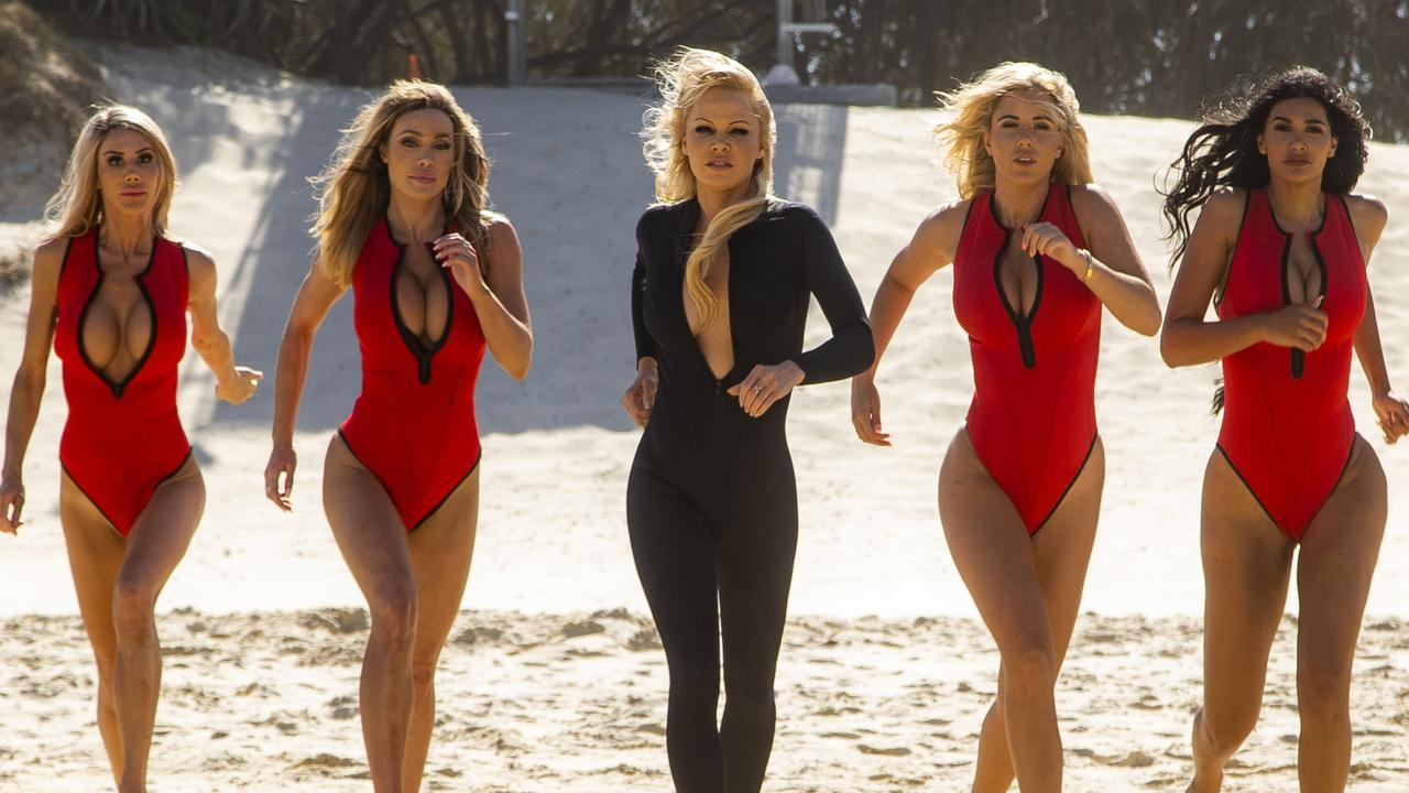 Jennifer Cole (left), Laura Lydall, Pamela Anderson, Tyana Hansen and Parnia Porsche at Main Beach, Gold Coast during the filming of the next Ultra Tune TV in 2019. Picture: CARMELO REDUNDO