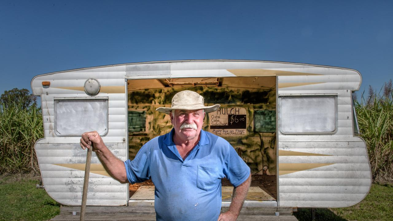 Caravan owner Eric Lyons stands in front of the replacement van he sells hay bales from at Palmers Island, after his original van was destroyed by a storm.