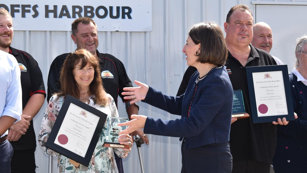 NSW Premier Gladys Berejiklian presented locals Dean Evers (right) and Aunty Kerrie Burnet with Community Service Awards in Coffs Harbour on October 26.
