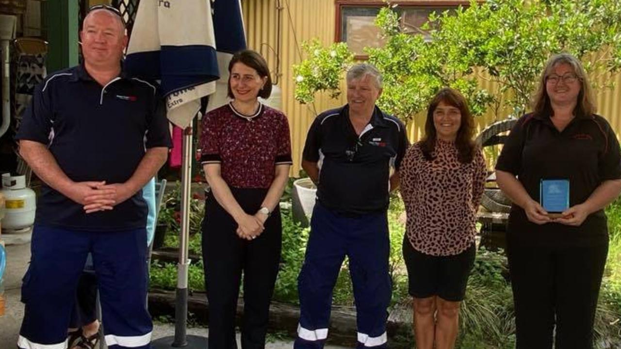 Stephen Joyce and Shannen Mitchell from the Nana Glen First Responders, Lisa Ralston from Nana Glen Preschool and Alison Johnson from the Idle In Cafe with NSW Premier Gladys Berejiklian in Nana Glen on Monday.
