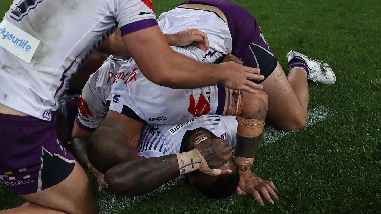 Suliasi Vunivalu celebrates Melbourne's grand final win in his final game before he switches to rugby union next season. Picture: Brett Costello
