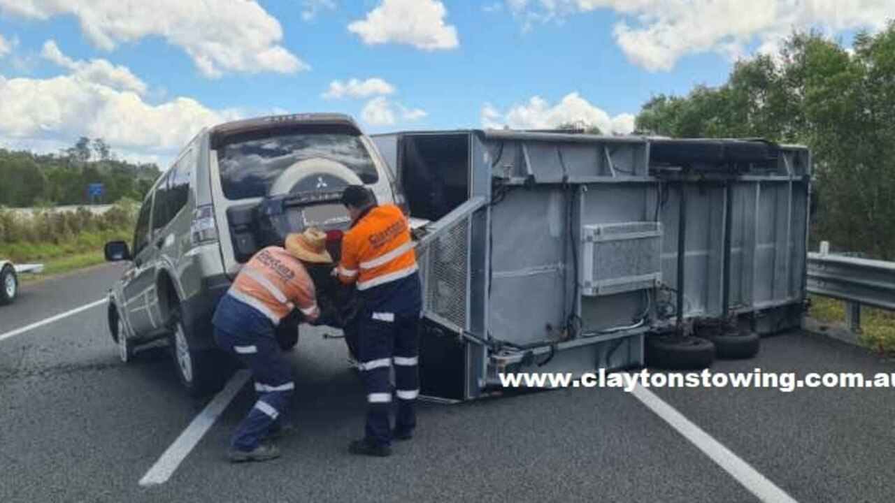 Emergency services have rushed to a caravan rollover on the Bruce Highway at Pomona. Picture: Clayton's Towing