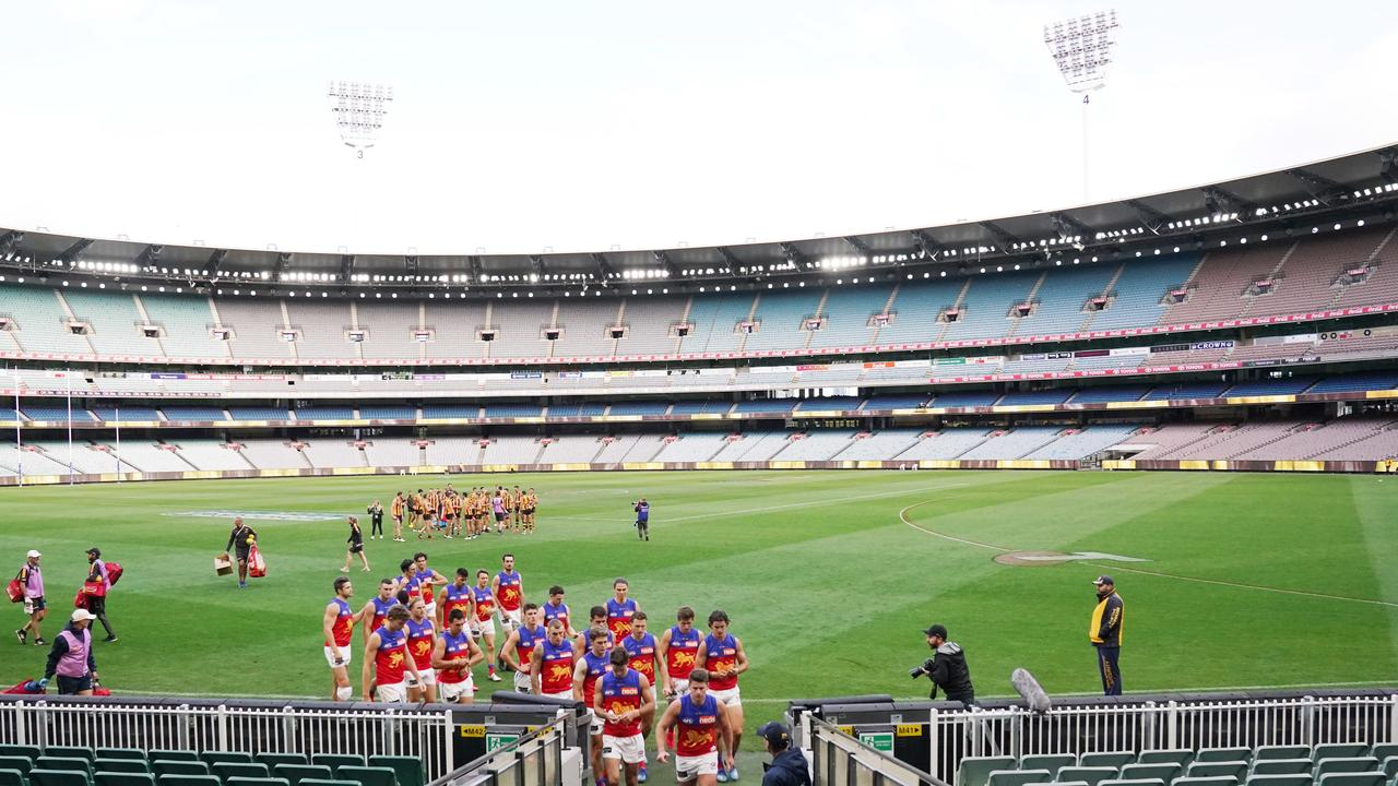 The Lions leave an empty MCG after their Round 1 loss to Hawthorn.