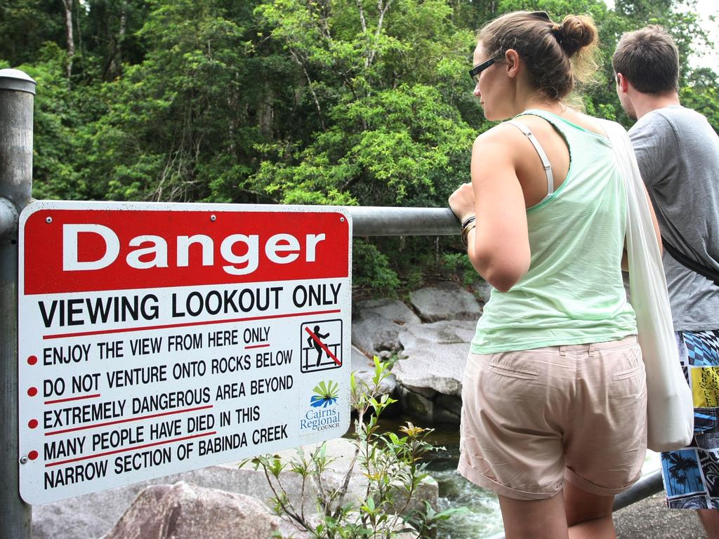 Signage warns tourists overlooking Devil's Pool of the danger entering Babinda Creek. Picture: Supplied/NCA NewsWire