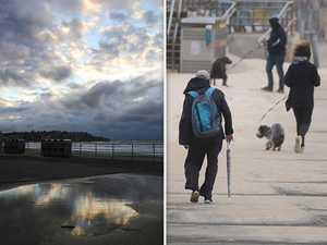 Wet, grey weather to stay as cold front sweeps NSW