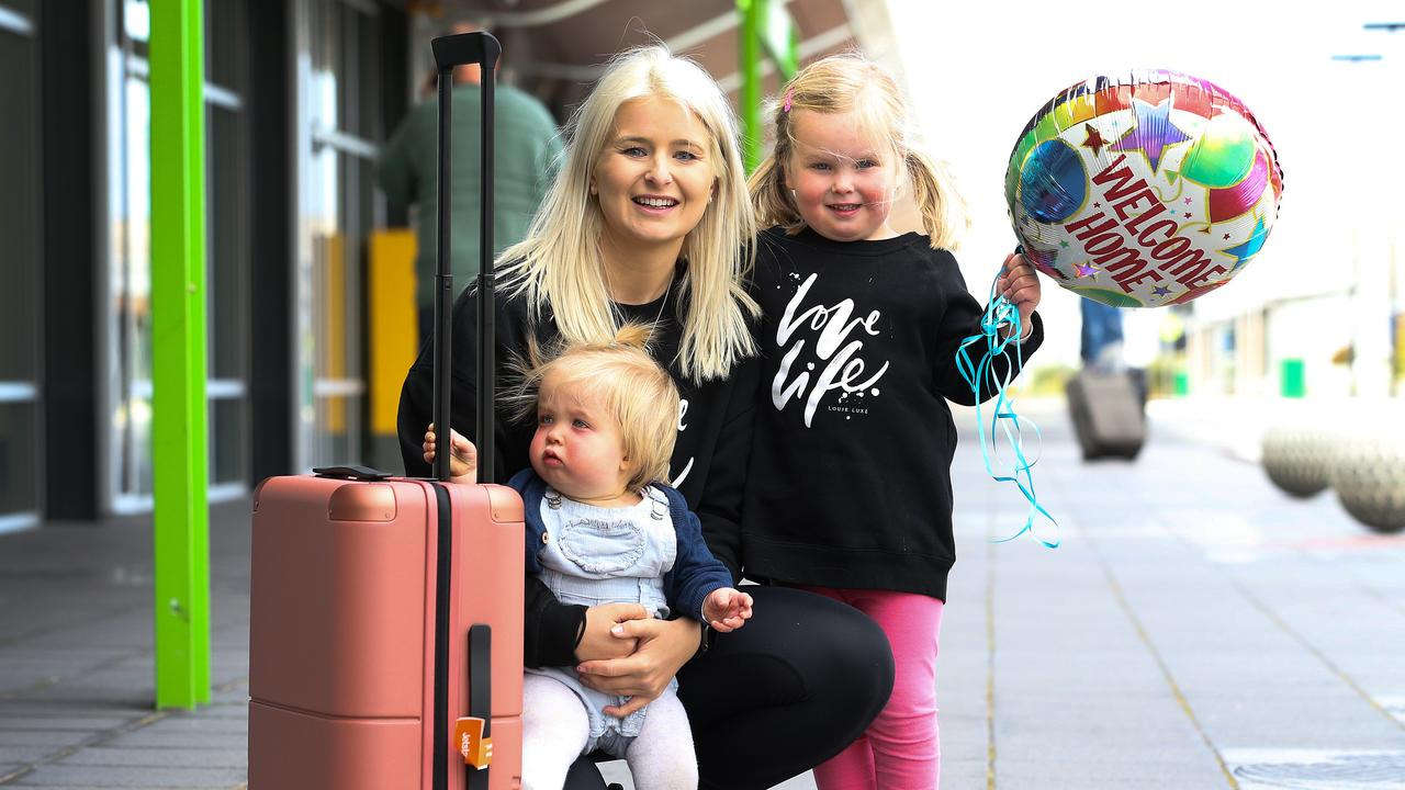 Sisters Nina, 1 and Sadie Myors, 4 are reunited with their aunty Emily Myors. Picture: Zak Simmonds