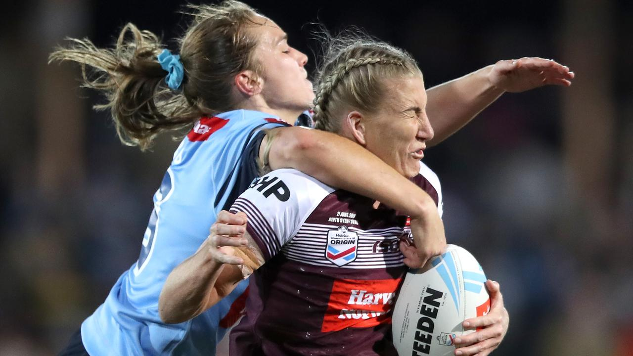 Ali Brigginshaw of QLD is tackled by Kirra Dibb of NSW during the Women's State of Origin last year. Picture: Mark Kolbe/Getty Images.