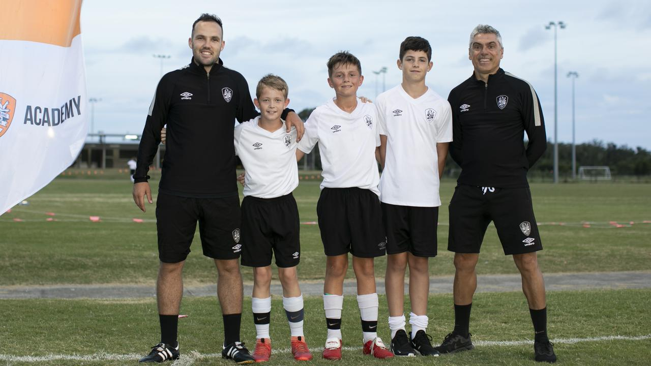 Caloundra's U12 SAP coach Mackenzie Smith with players Rhys Williams, Luca Holder, Luca Skoullos and SAP director Rui Spinola. Picture: Megan Gill Photography