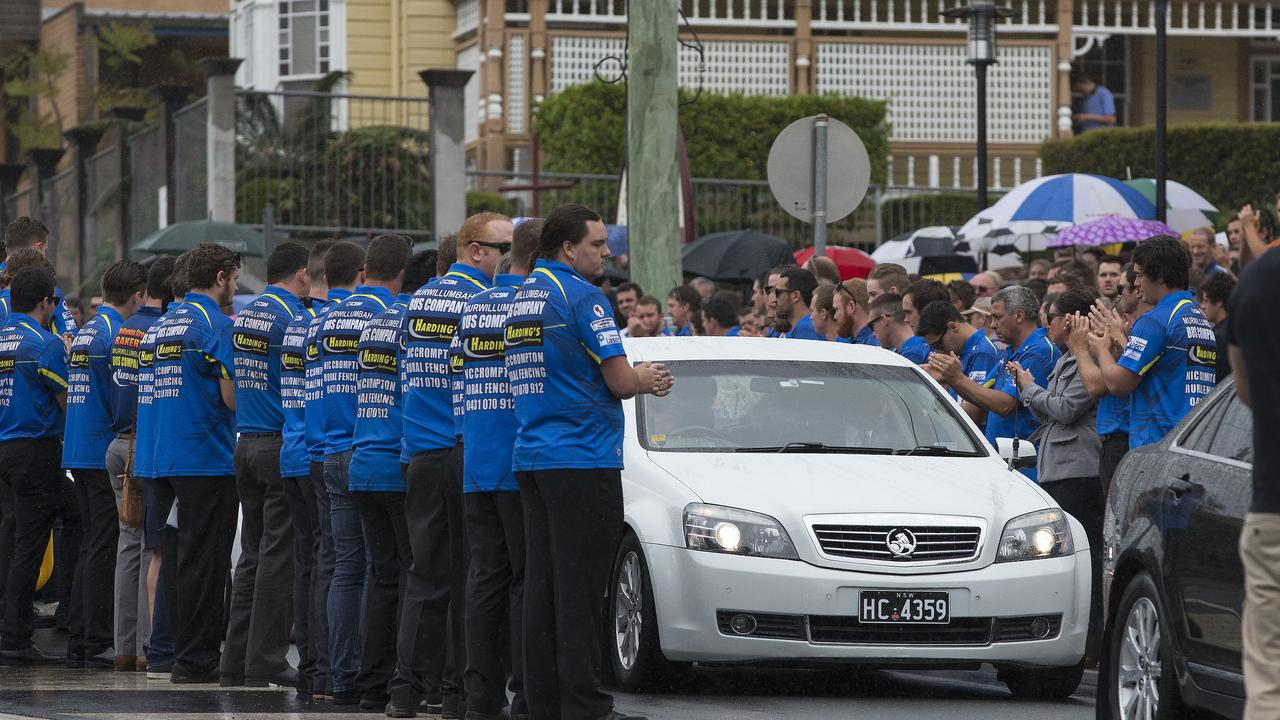 Funeral service for Grant 'Cookie' Cook at the Sacred Heart Catholic Church, Murwillumbah. The Murwillumbah Mustangs rugby players forming a line outside the church. . Photo: Jerad Williams