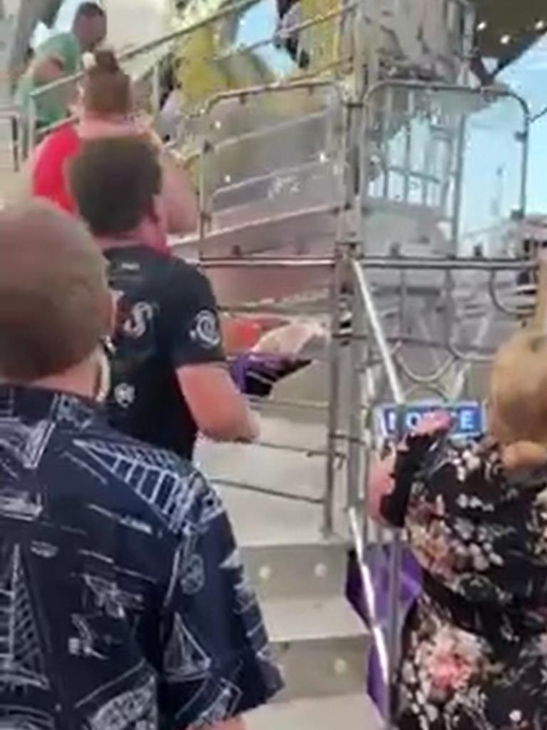 People look on in horror after a 25-year-old woman fell about 30m from the Hang Over ride at the Cairns Showfest. PICTURE: SCREENSHOT