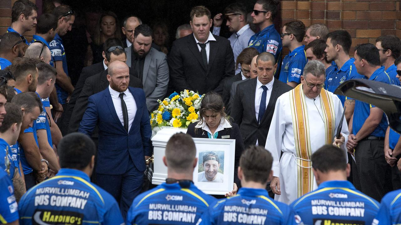 Funeral service for Grant 'Cookie' Cook at the Sacred Heart Catholic Church, Murwillumbah. The Murwillumbah Mustangs rugby players forming a line outside the church. Photo: Jerad Williams