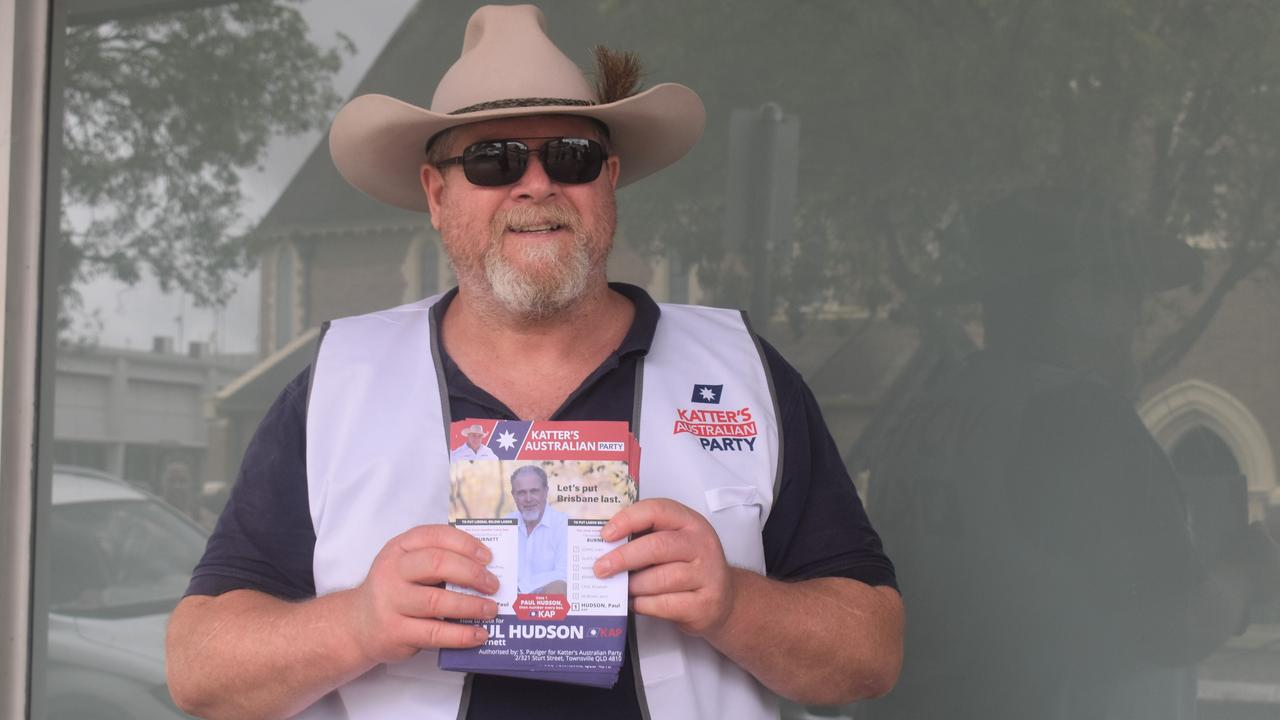 Richard Love hands out how-to-vote cards for Katter's Australian Party's Paul Hudson.