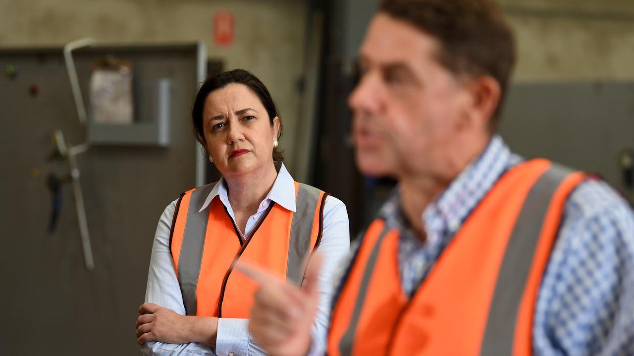 Premier Annastacia Palaszczuk listens to Treasurer Cameron Dick on a campaign visit in Mackay. Picture: NCA NewsWire / Dan Peled