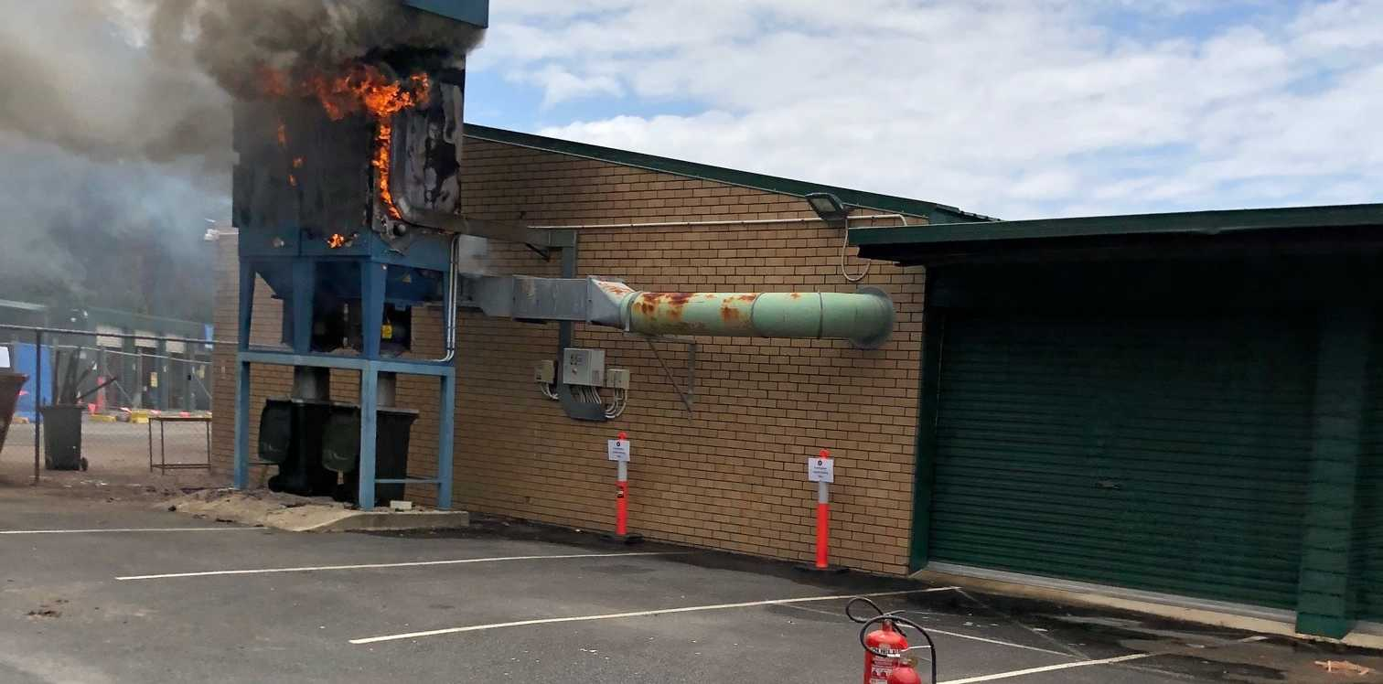 Firefighters contained a blaze at John Paul's College in Coffs Harbour today. The fire began in a hopper containing sawdust.