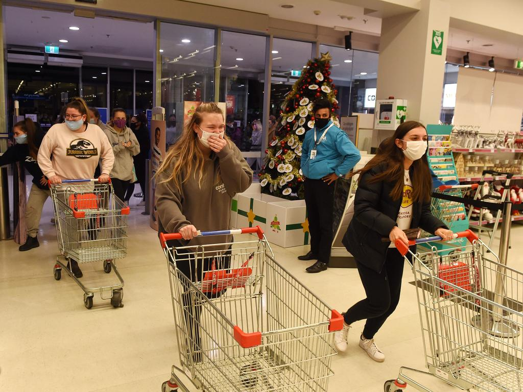 Some shoppers queued for hours to ensure they would be the first to cross the threshold when Kmart stores reopened at midnight in Melbourne. Picture: Josie Hayden