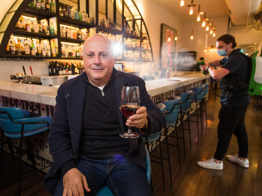 Chin Chin Melbourne restaurant owner Chris Lucas prepares to reopen with the help of Stephen Giderson from Whizz Cleaning. Picture: NCA NewsWire / Paul Jeffers
