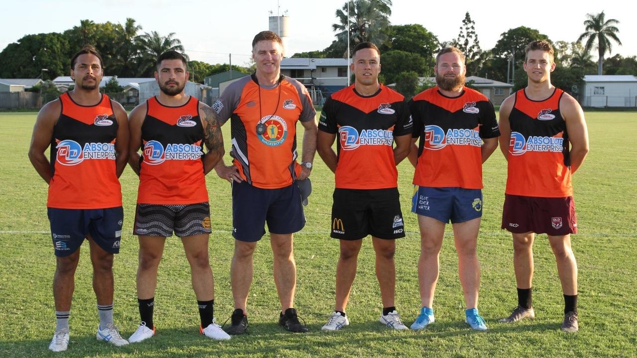 Wests Tigers coach Craig Menkins (third from left) will go around again next year after leading the club to the 2020 A-Grade premiership.