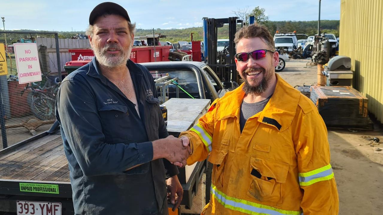 Rick Williams from Williams Auto Wreckers with Calliope Rural Fire Service's Shawn Butler on the day of the donation.