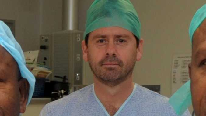 Surgeon facing sacking sues critics