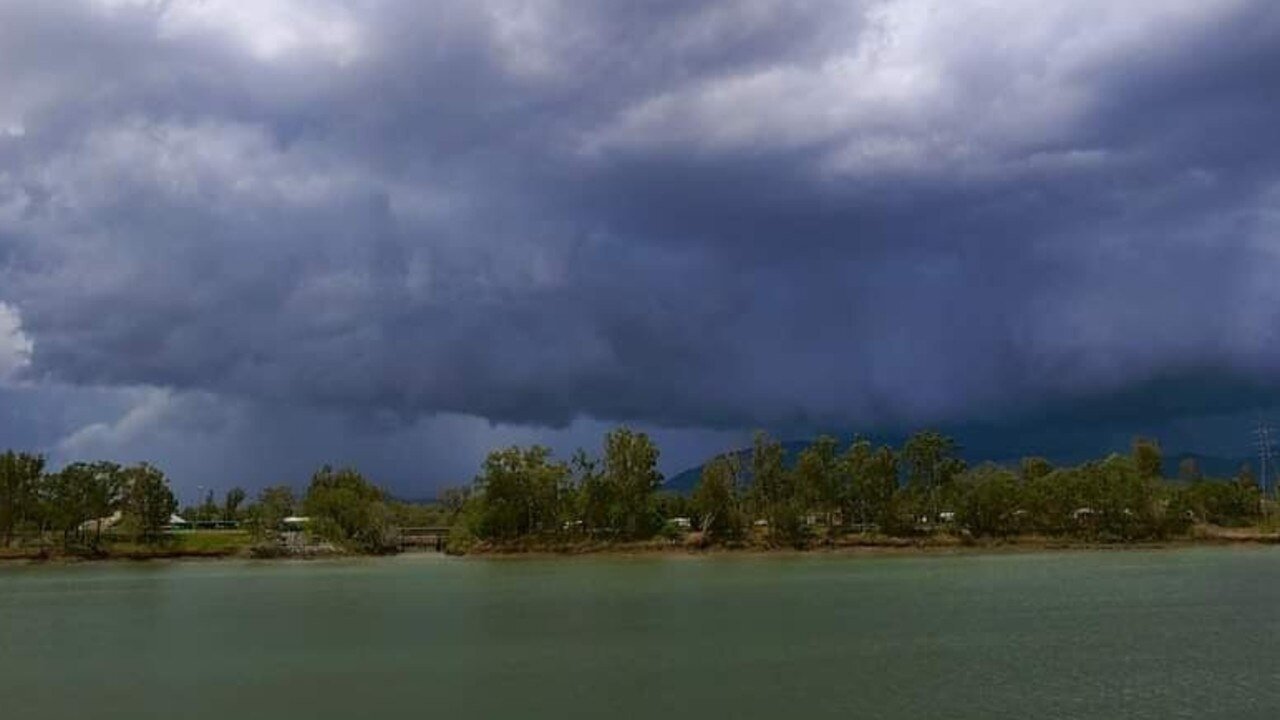 Dark clouds are seen rolling across the Fitzroy River this afternoon.
