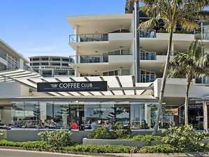 Coast Coffee Club building hits market