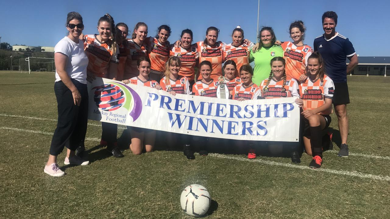 Whitsunday United Premier Reserves team receive their championship banner for finishing on top of the ladder at the end of the 2020 regular season.