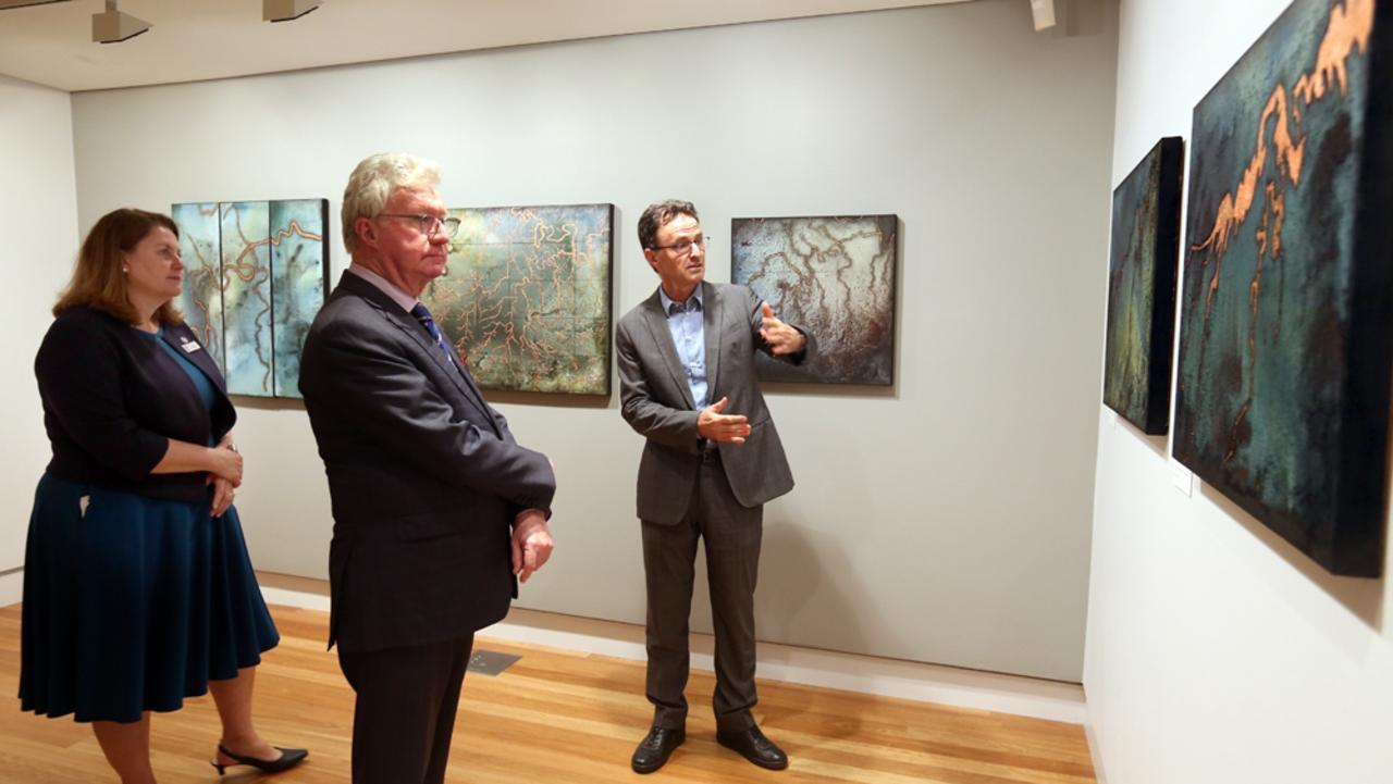 Ipswich Mayor Teresa Harding, Queensland Governor Paul de Jersey and Ipswich Art Gallery director Michael Beckmann discuss the exhibition by local artist Kyle Stevens, Ways of Water.