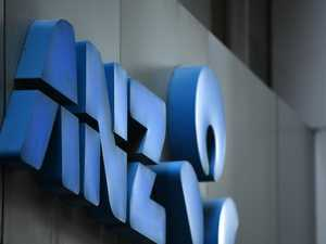 ANZ suffer profit plunge as bank defends climate policy