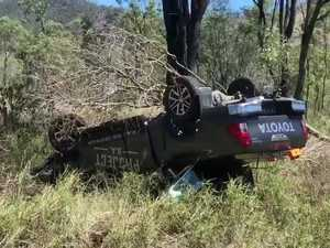 A vehicle believed to be stolen has overturned on the Burnett Hwy.