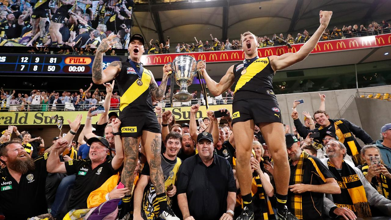 Tigers Dustin Martin (left) and Noah Balta savour their historic AFL grand final victory at the Gabba. Picture: Michael Willson/AFL Photos via Getty Images