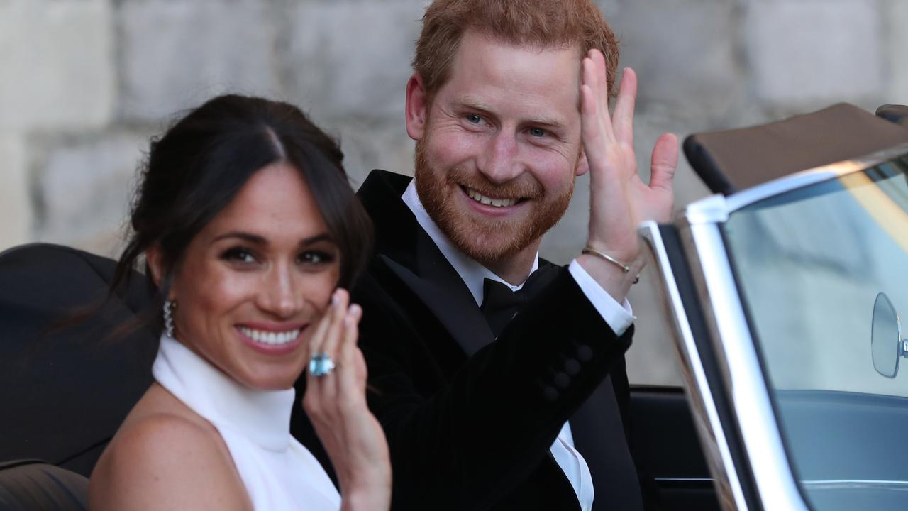 Meghan Markle and Prince Harry basking in the adoration of A-list celebs on their wedding day. Picture: Steve Parsons Getty