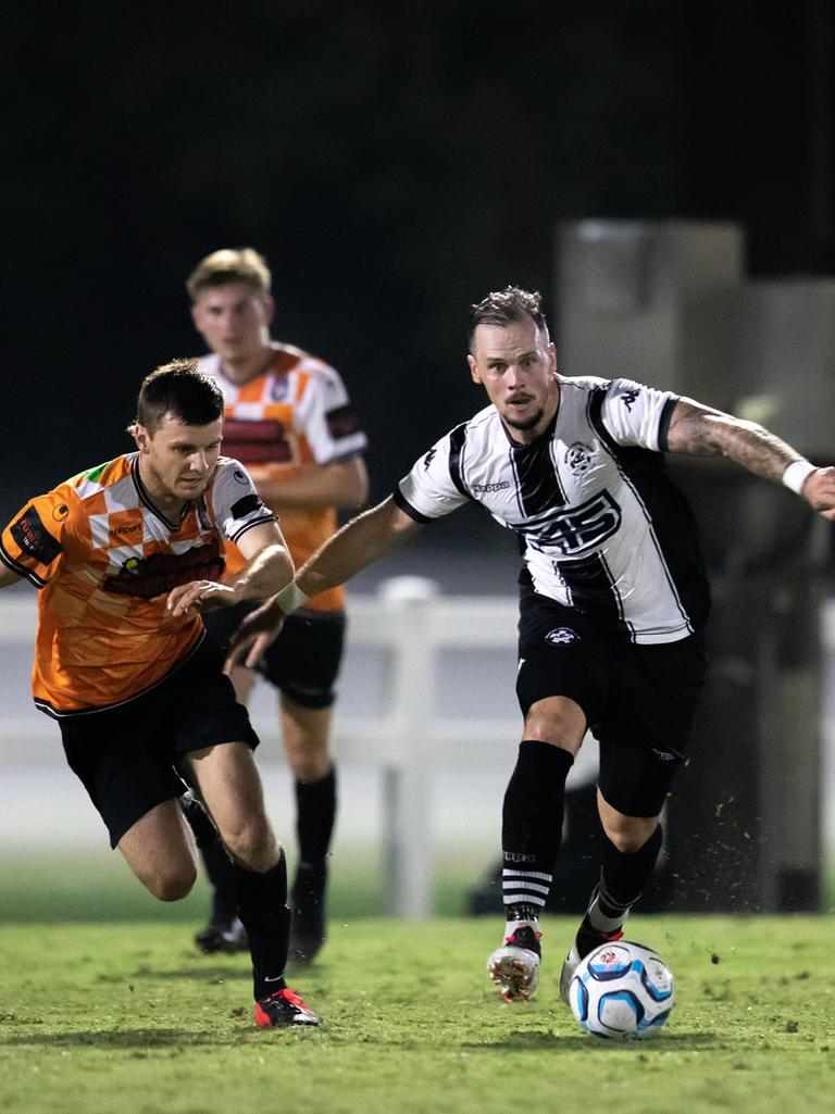 Magpies FC player/coach Michael Lyall in action against Whitsunday FC in the Mackay Premier League.