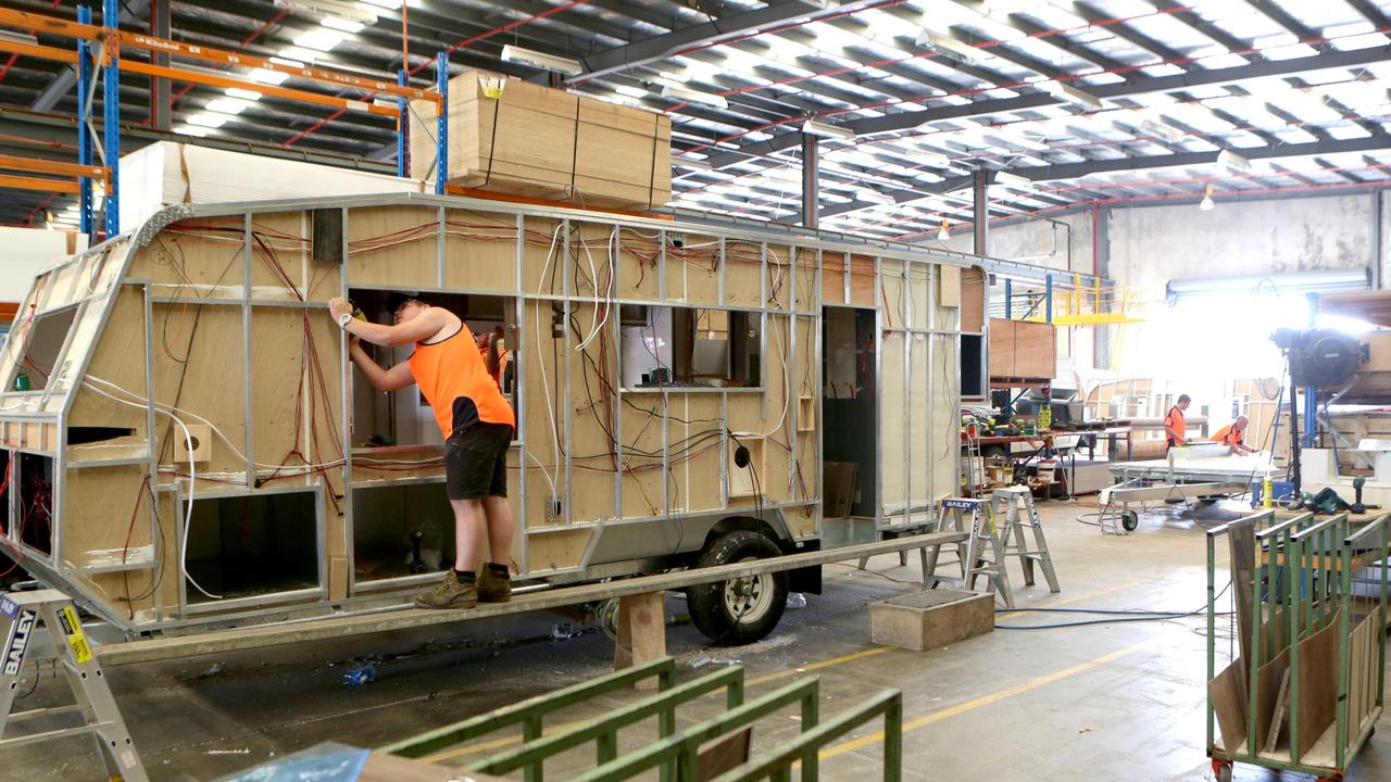 Dozens of luxury caravans are lying idle at one of Australia's biggest caravan manufacturers as grey nomads remain locked out of Queensland.