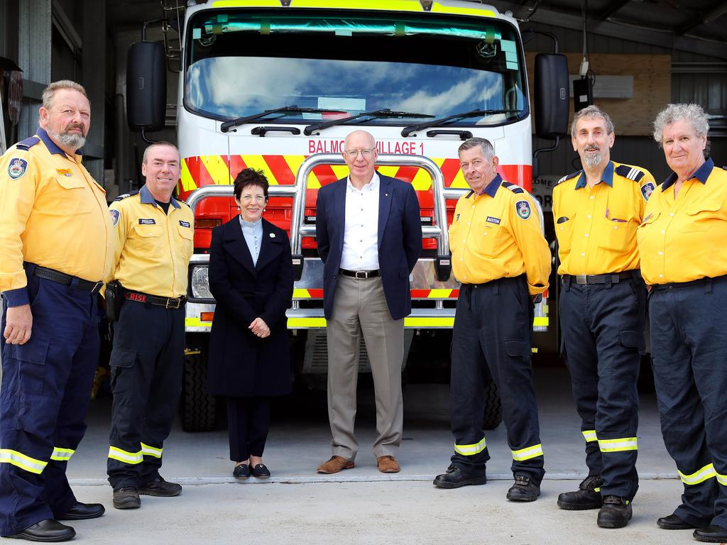 Volunteers — pictured here with Governor-General David Hurley and his wife Linda Hurley — should not be financially disadvantaged, the report said. Picture: Tim Hunter