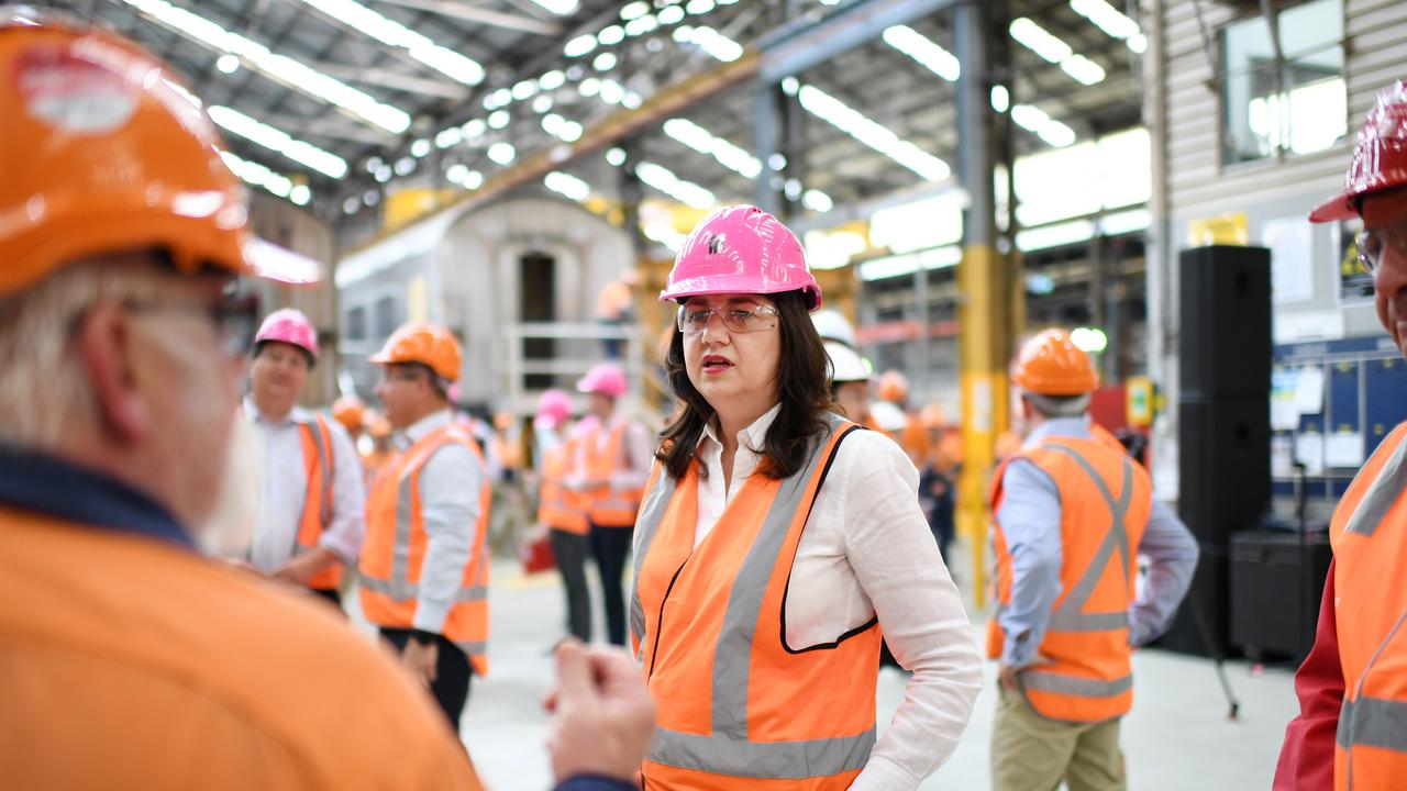 MARYBOROUGH, AUSTRALIA – NewsWire Photos – OCTOBER 13, 2020. Queensland Premier Annastacia Palaszczuk talks to a worker during a visit to the Downer train building facility, as she campaigns for her re-election. Ms Palaszczuk announced a $600 million commitment for 20 new trains to be built in Maryborough, should Labor win government on October 31. Picture: NCA NewsWire / Dan Peled