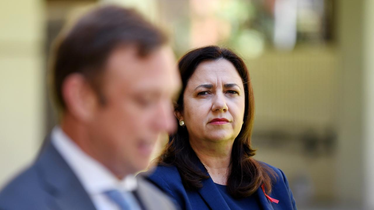 Premier Annastacia Palaszczuk watches her deputy Steven Miles during a press conference at Parliament House. Picture: NCA NewsWire / Dan Peled