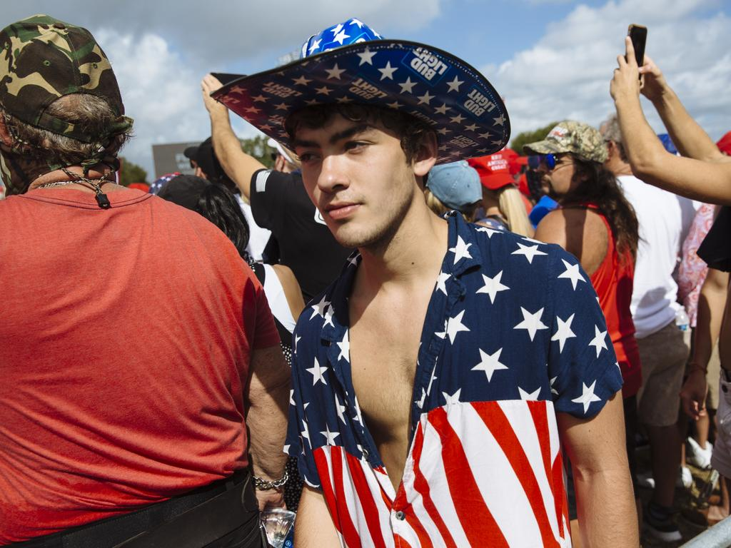The crowd at Mr Trump's rally in Tampa, Florida, was mostly maskless. Picture: Angus Mordant
