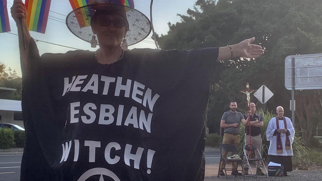 Meeting outside Noosa's Black Satanic Mass is president of LGBTI Rainbow Noosa Lesley Pantlin and a group of Catholics.