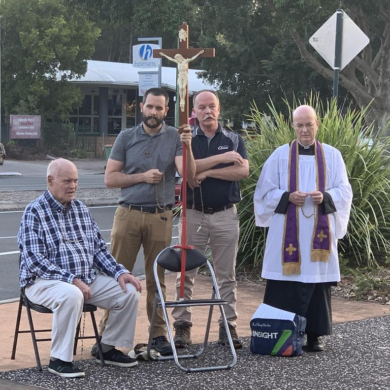 A small group of Catholics held a silent protest outside Noosa's Satanic Black Mass.